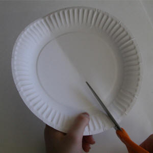 Fold and cut the paper plate in half. & Paper Plate Rabbit Craft