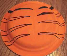 draw stripes on plate & Tiger Paper Plate Craft