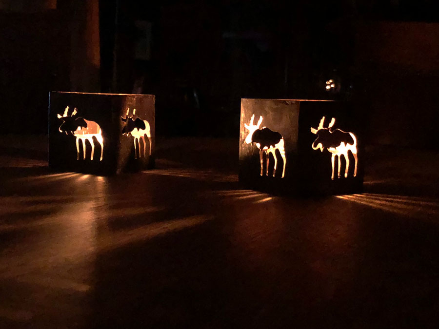 Moose candle holders lighting up the dining room at Num Ti Jah during a power outage.
